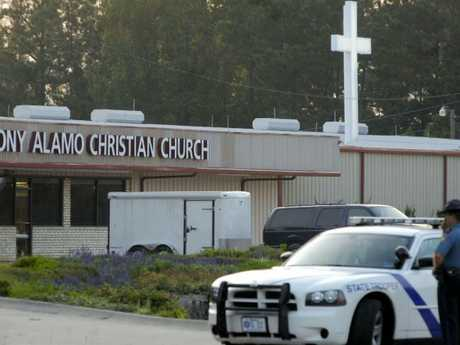 Police and FBI agents raid the Tony Alamo Christian Church in Fouke, Arkansas in 2008 as part of a child pornography investigation. Picture: AP/Mike Wintroath