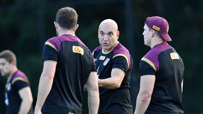 Enforcer underdone? Former player Gorden Tallis (centre) is seen talking to the Queensland forwards during Queensland State of Origin team training at Clive Berghofer Field in Brisbane, Tuesday, May 29, 2018. Queensland are in camp to prepare for game one of the 2018 State of Origin series against New South Wales. (AAP Image/Darren England) NO ARCHIVING, EDITORIAL USE ONLY