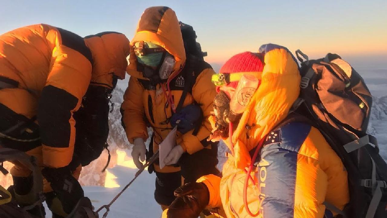 Alyssa Azar at the top of Mount Everest two Sherpas.