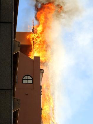 Twelve firetrucks are at the scene. Picture: John Grainger