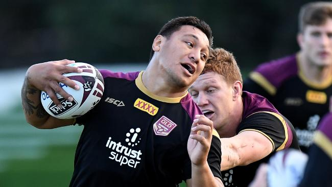 Josh Papalii attempts to break away from the defence during a Queensland Maroons State of Origin training session at Sanctuary Cove. Photo: Getty Images