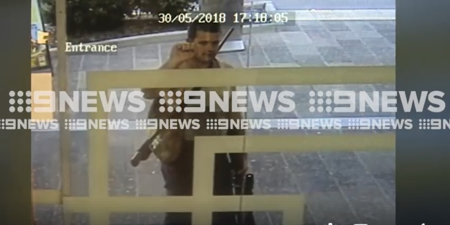 The moment an alleged gunman locks down the Mackay CBD.
