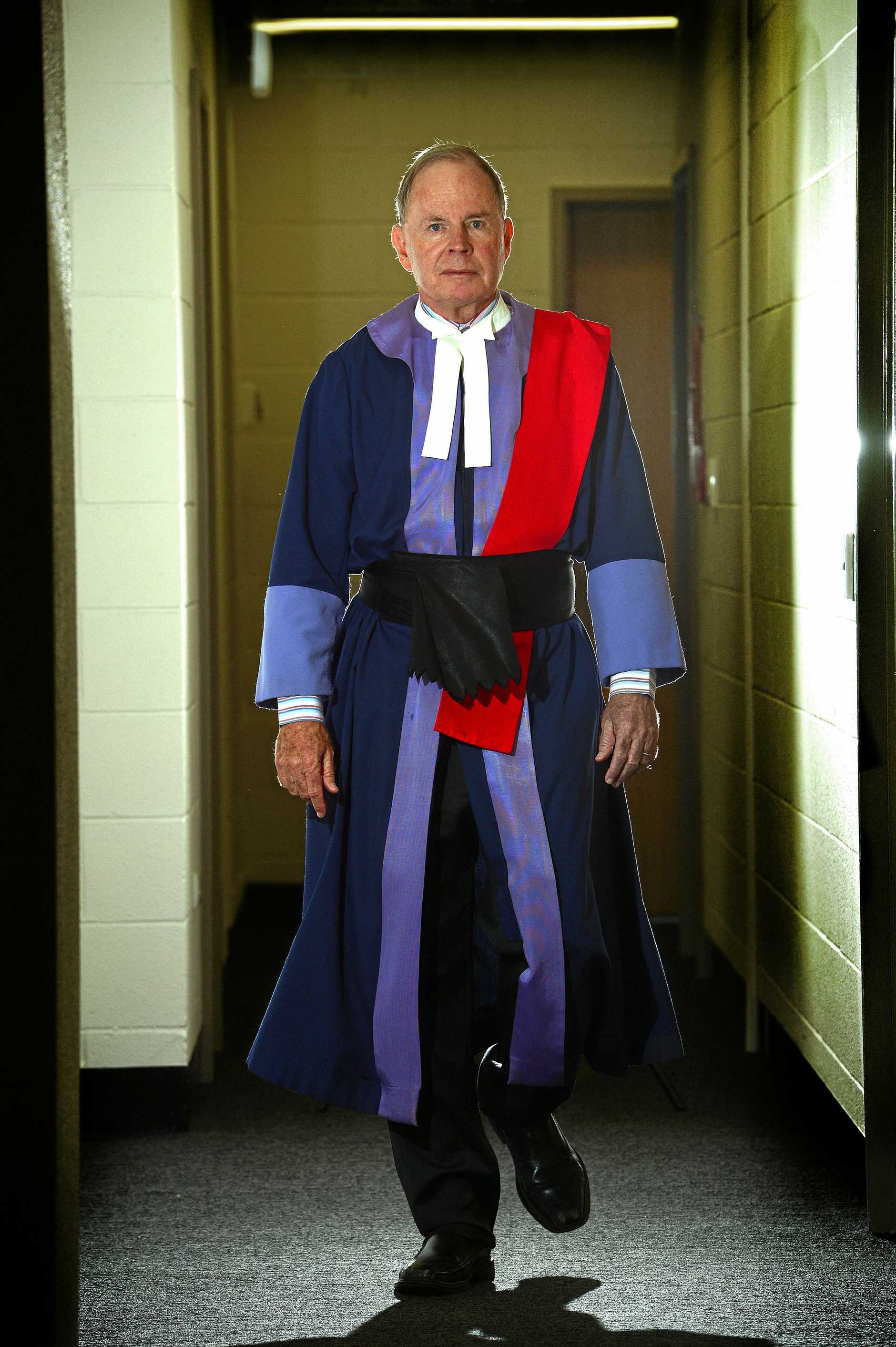 ONE FINAL WALK: Judge John Robertson at Maroochydore courthouse in the corridor walking to the courtroom. John Robertson is set to retire.