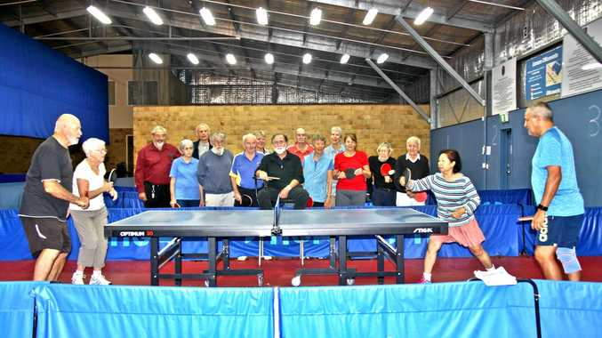 GAME ON: Members of the Lismore Table Tennis Club watch Leon Horan and Margaret Loong take on Oan Gasorn and Brian Johnson.