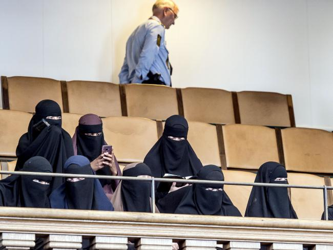 Women wearing the niqab watch Danish parliament vote on banning garments that conceal the face. Picture: Mads Claus Rasmussen/Ritzau Scanpix