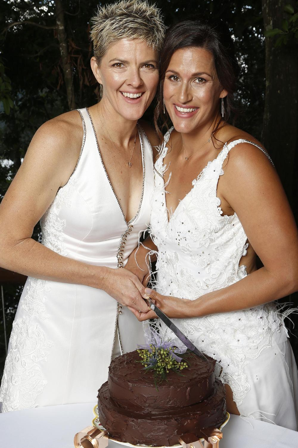 Five-time Olympian marries her partner Sarah Maxwell at Secrets at Montville with their chocolate ganache wedding cake made by Krista Pappas