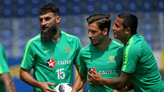 Mile Jedinak, Mathew Leckie and Cahill. Picture: Toby Zerna