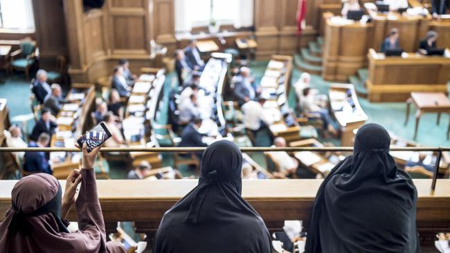 Women wearing niqabs sit in the audience seats of the Danish Parliament. Picture: Mads Claus Rasmussen/Ritzau Scanpix
