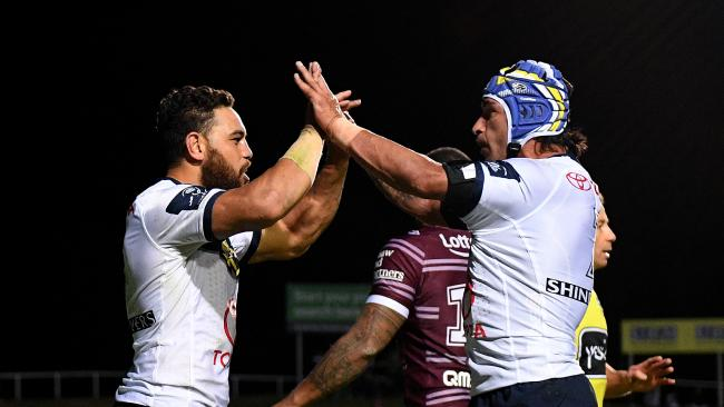 Antonio Winterstein of the Cowboys (left) celebrates with Johnathan Thurston after scoring a try. (AAP Image/Dan Himbrechts)