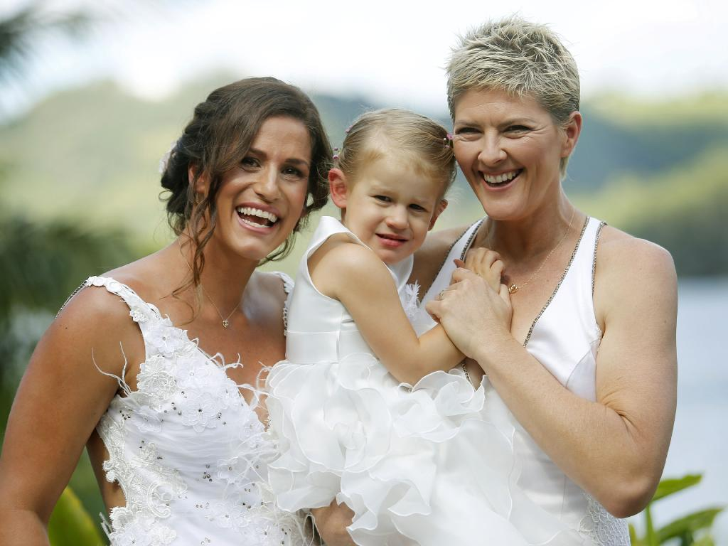 Sarah Maxwell and wife Natalie Cook with their daughter Jordan