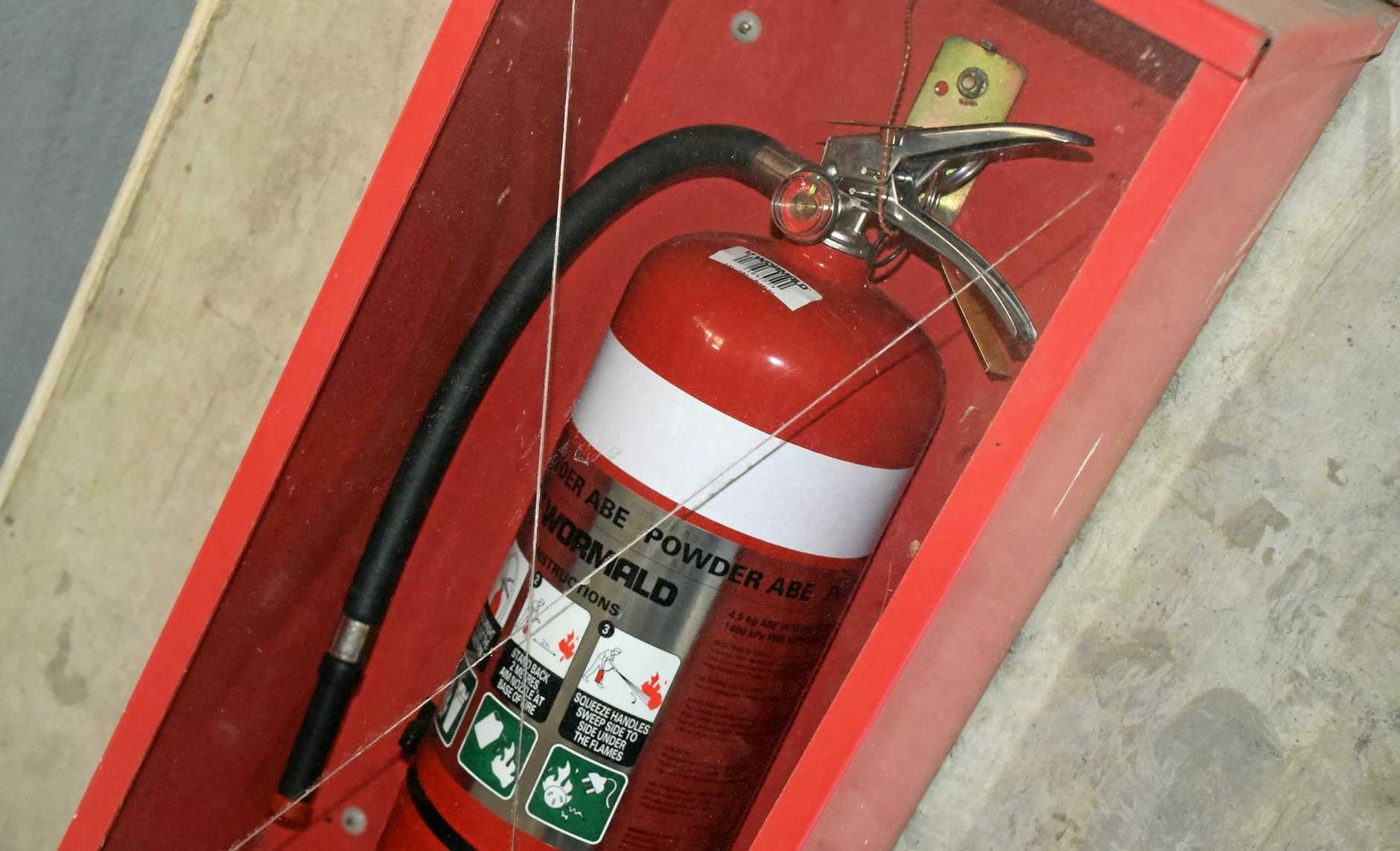 FILE PHOTO: A fire extinguisher with its labels removed was found nearby (not the fire extinguisher in question).
