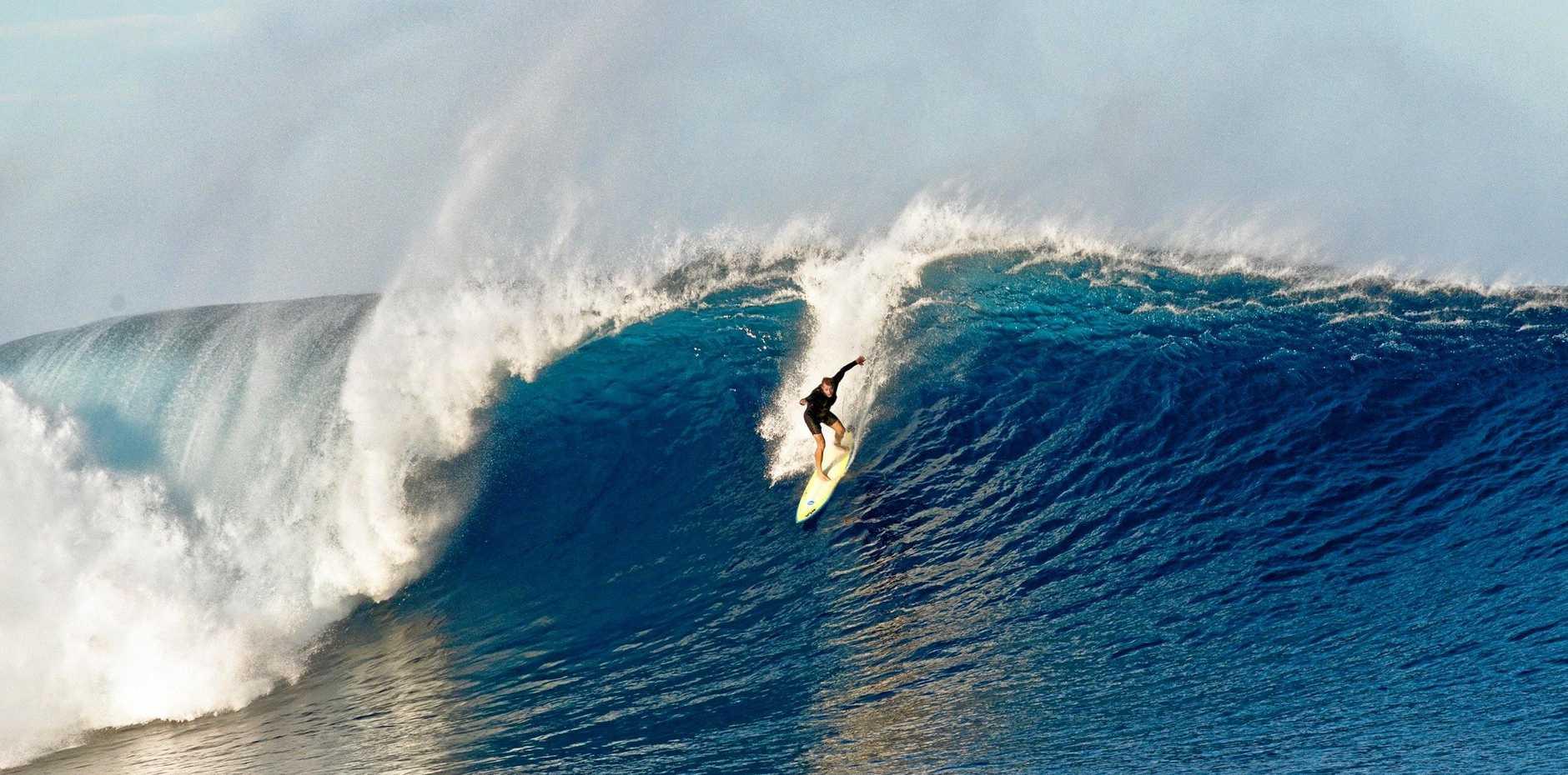 SUNSHINE Coast lifeguard supervisor (north) Anthony King drops into a Cloudbreak bomb off Tavarua Island in Fiji