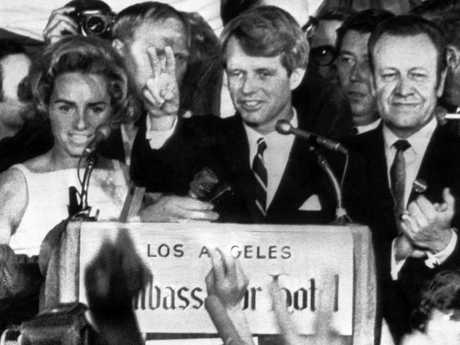 In this June 5, 1968 file photo, presidential hopeful Sen. Robert F. Kennedy waves goodbye to his supporters as he prepares to leave the Ambassador Hotel ballroom in Los Angeles, before exiting through a kitchen backstage. Picture: AP