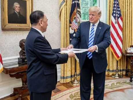 Kim Yong Chol gives and Donald Trump a letter from Kim Jong-un. Picture: White House