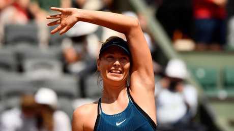 Russia's Maria Sharapova celebrates.