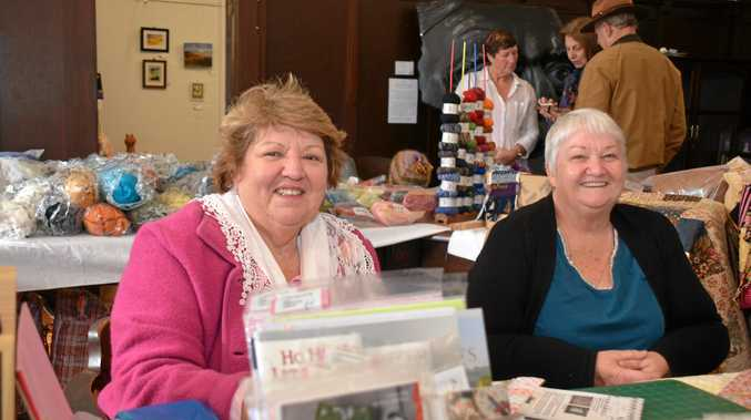 Rosslyn Skehelton and Esther Roberts attend their Winter Craft festival stall.