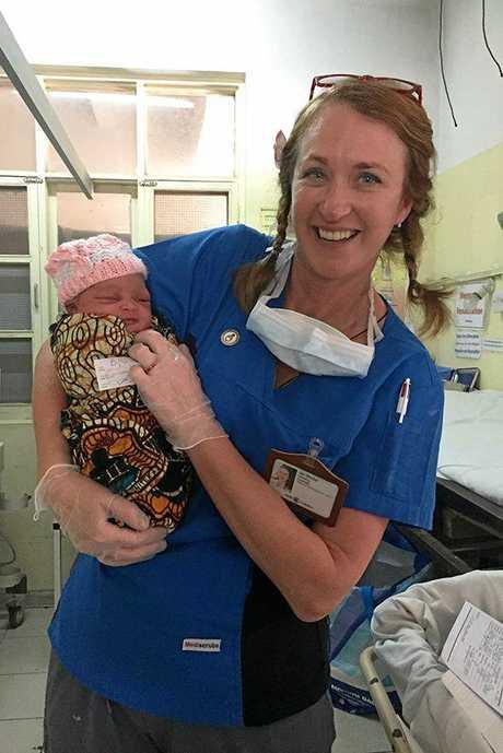 Jan Becker with a baby at a Tanzanian hospital.