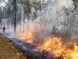 Dry grass causes risks as crew battles blaze near Warwick