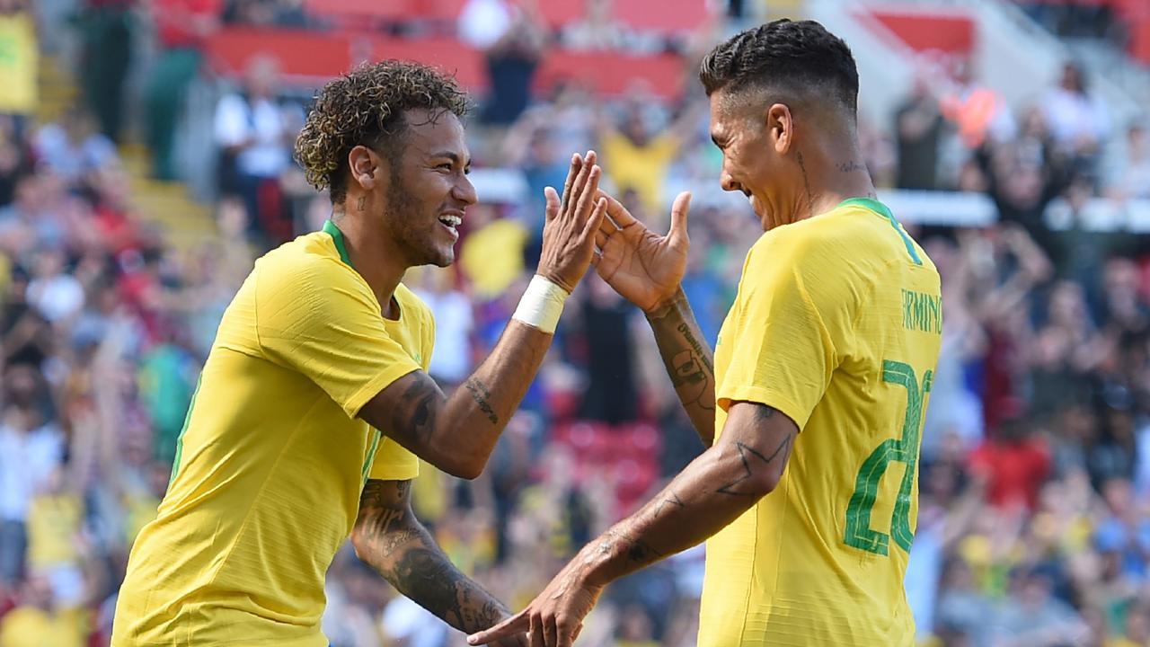 Brazil's striker Roberto Firmino (R) celebrates with Brazil's striker Neymar after scoring their second goal