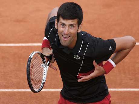 Serbia's Novak Djokovic cheers the audience after defeating Spain's Fernando Verdasco.