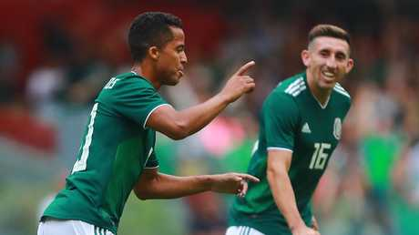 Giovani Dos Santos of Mexico celebrates after scoring the first goal