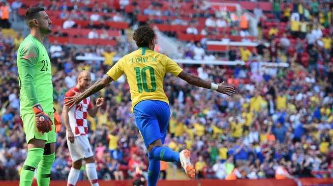 Croatia's goalkeeper Danijel Subasic (L) reacts as Brazil's striker Neymar celebrates after scoring the opening goal