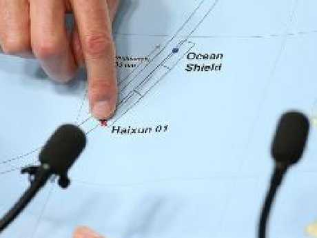 An Australian official points to the patch of ocean near the 7th arc where Chinese navy ship Haixun picked up 'pings' believed to have come from MH370 in 2014. Picture: Getty