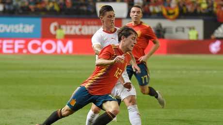Spain's forward Alvaro Odriozola (front) vies with Switzerland's midfielder Steven Zuber