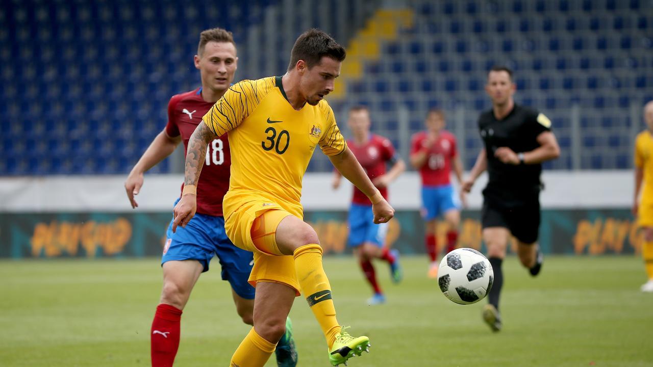 Socceroos Jamie Maclaren controls the ball