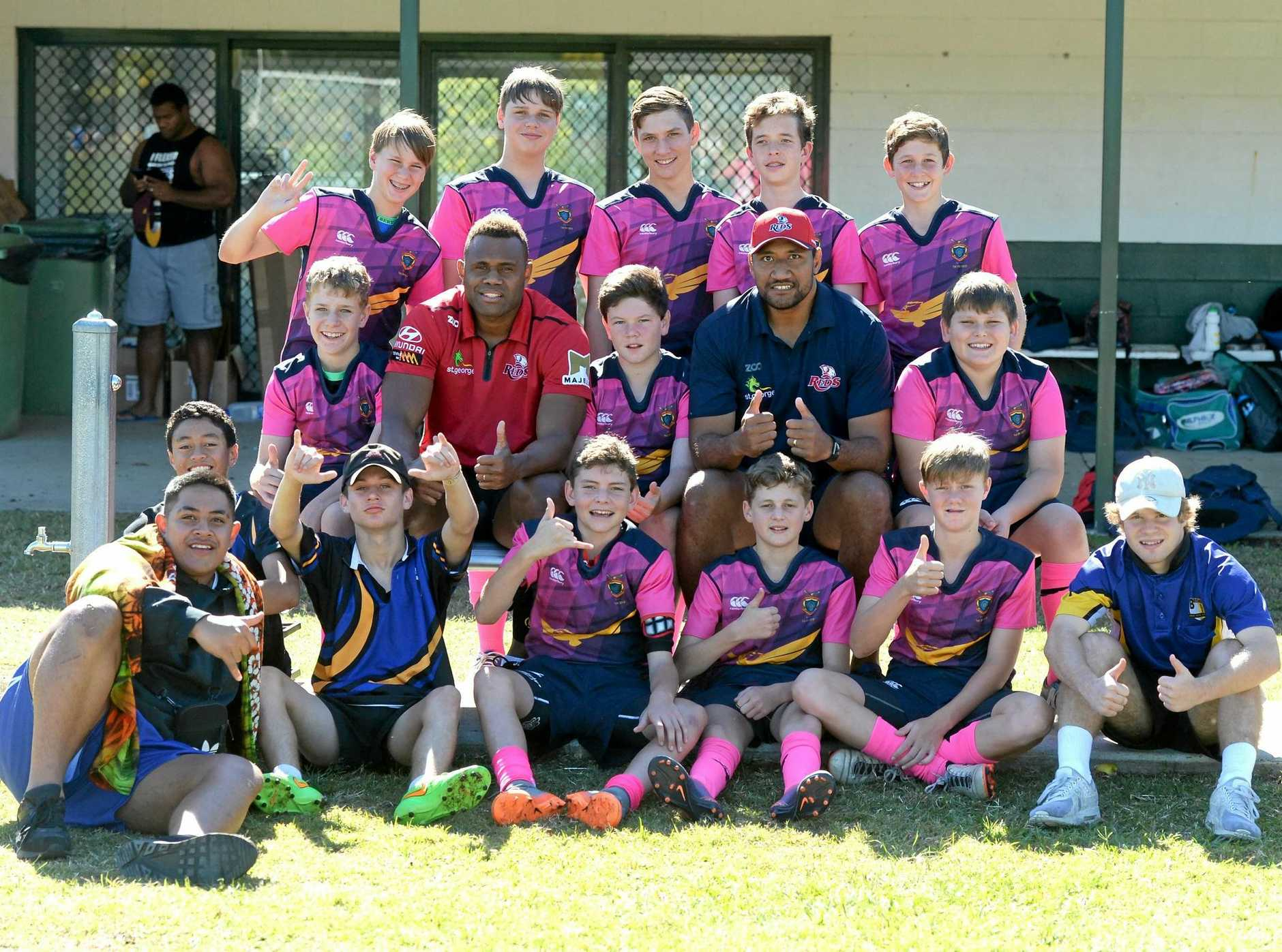 NEXT GENERATION: Queensland Reds winger Eto Nabuli and QRU Development Officer Josh Afu mix with kids at the CISSSA Rugby 7s tournament at the Ipswich Rangers field at Woodend.