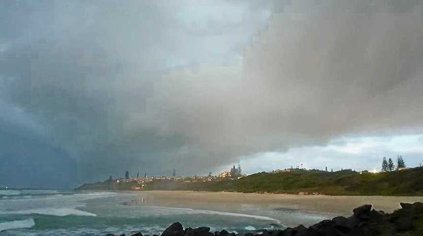 Heavy rain and possible thunderstorms are forecast to hit the Sunshine Coast as a band of heavy clouds rolls north.