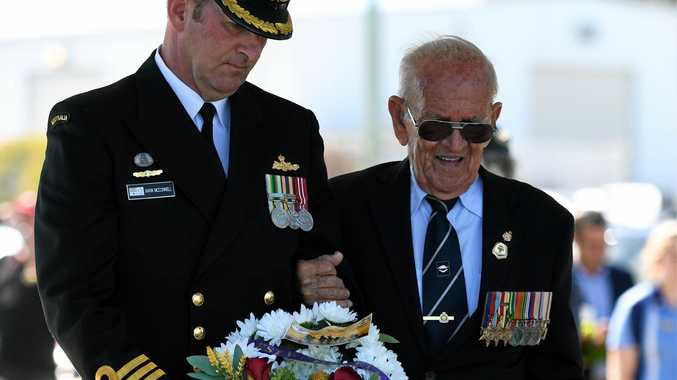 Cmdr Mark McConnell and Rat of Tobruk Gordon Wallace place a wreath at the farewell ceremony.
