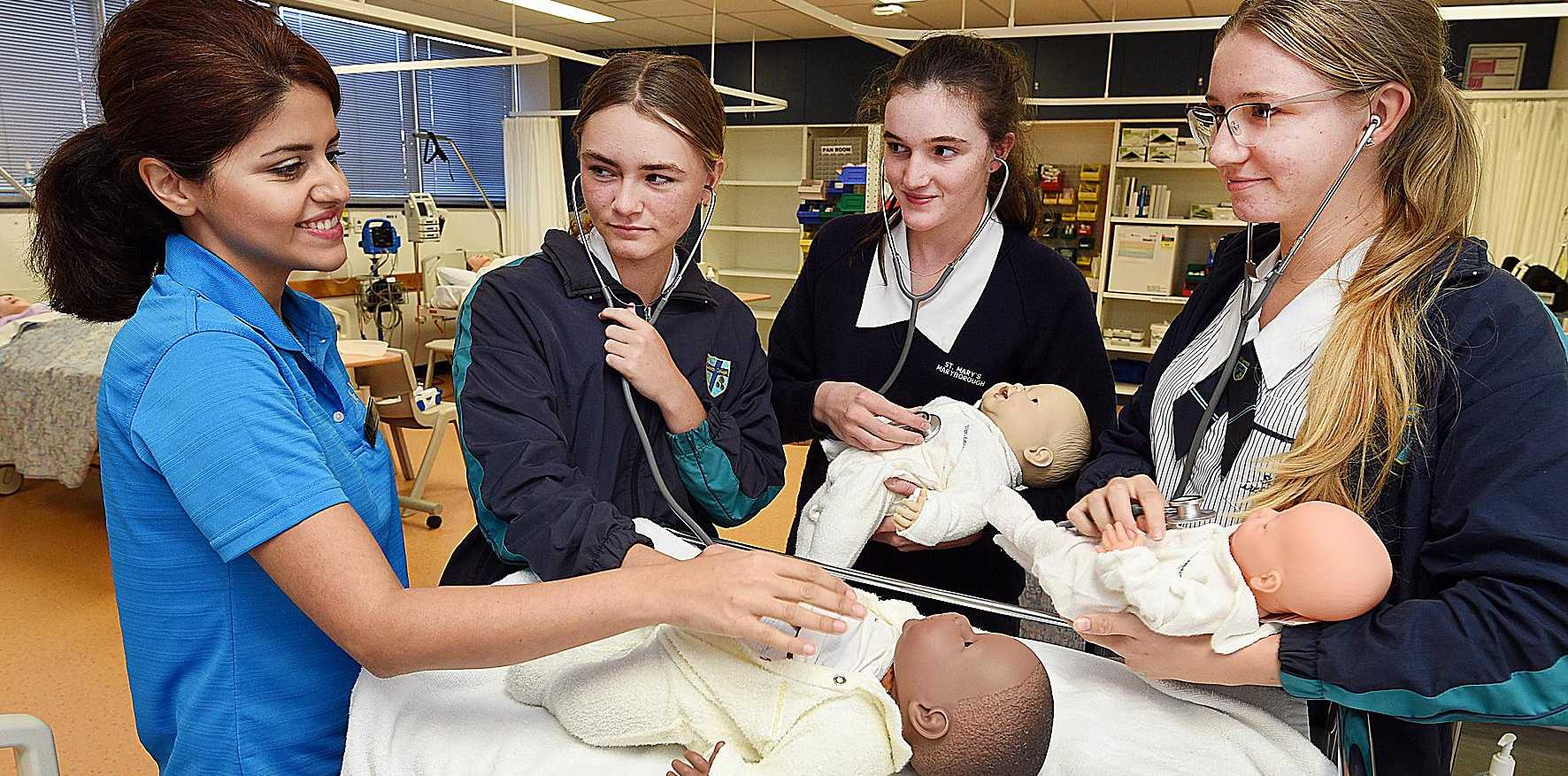 HANDS ON: Second year nursing student Hedi Soleiman with Lily Browning (St. James) , Millie Mushan (St. Marys) and Tara Naeger (St. James).