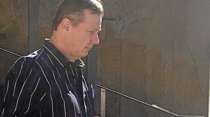 ADJOURNED: David Waden leaves court after admitting to weapons offences.