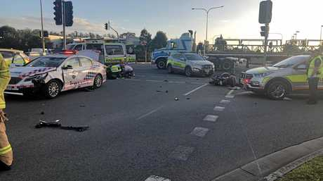 A man was hospitalised after his motorcycle and a police car collided.
