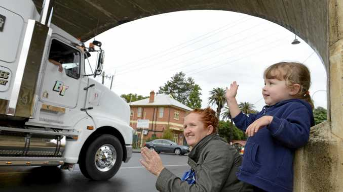HONK, HONK: Shona Laurie and her daughter Lilly Rose braved the wet of last year's June long weekend to watch the 2017 trucking parade along Prince Street, Grafton as part of the annual Grafton Truck Show.
