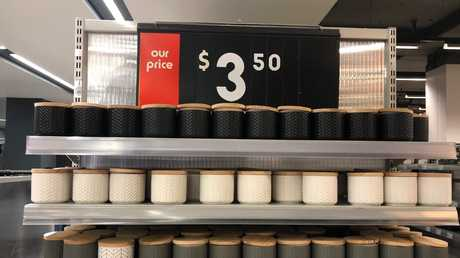 $3.50 canisters at Kmart. Snazzier containers are more expensive at Howards, but not by much.