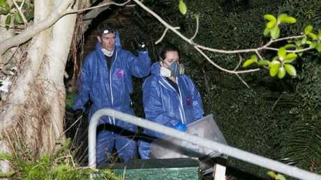 Police and forensics officers searching through the house in Greenwich, after the mummified body of Shane Snellman was found. Picture: Dylan Robinson.