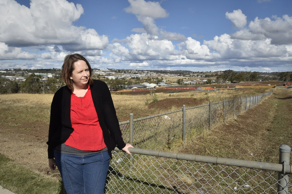 Glenvale State School parent, Melissa Greensill at the eastern boundary of the school. Government and council start planning new car park after long-term problem with traffic numbers which makes school drop-off very dangerous. May 2018