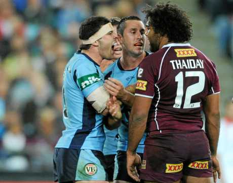 Michael Ennis shows his passion as he faces off against Queensland rival Sam Thaiday.