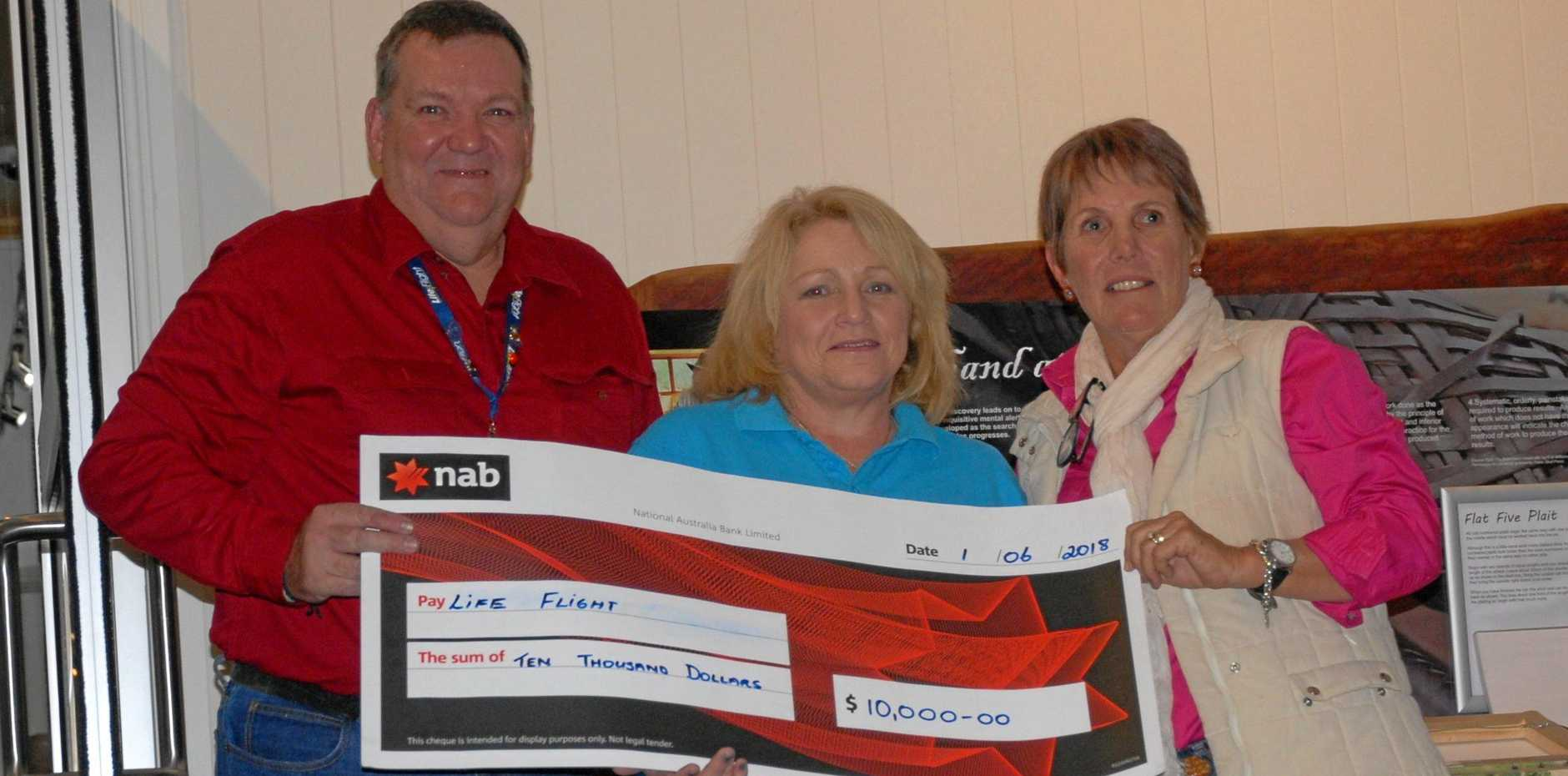 HUGE DONATION: Life Flight representatives received a cheque of $10,000 from the Eidsvold Charity Cattle Drive on Friday night.