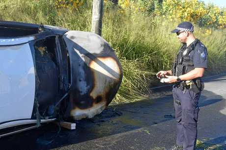 Gympie police officer Jeremy Gardiol was one of the first people on scene who pulled the 76-year-old man through the windscreen to save him from the burning car.