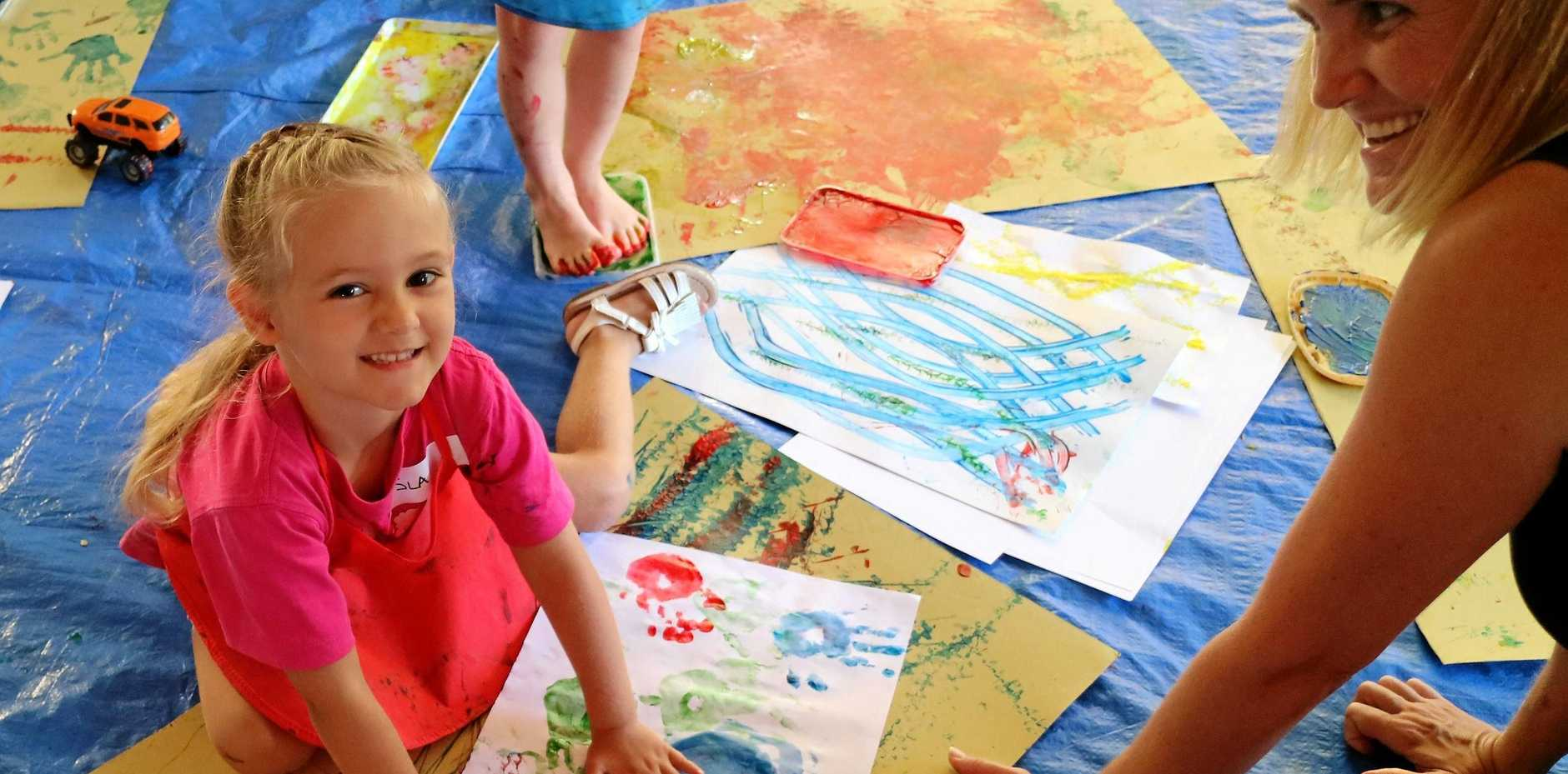 GET CREATIVE: Isla Ahern with Mother Rebecca Ahern had a great time hand painting during the recent Art Play session.