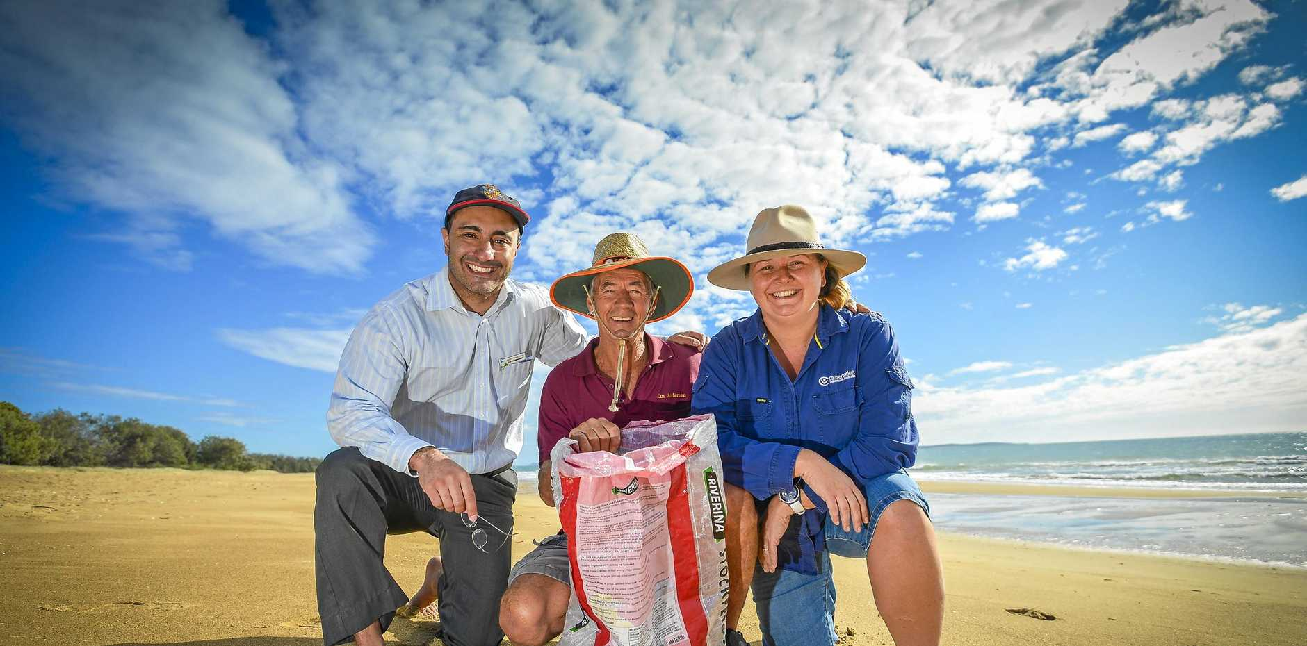 Gladstone regional councillor PJ Sobhanian, membership chairperson for Boyne Island Lions Club Ian Anderson and Regional Manager of Conservation Volunteers Australia Linda Fahle on Tannum Sands Beach, after it was named Queensland's Cleanest Beach.