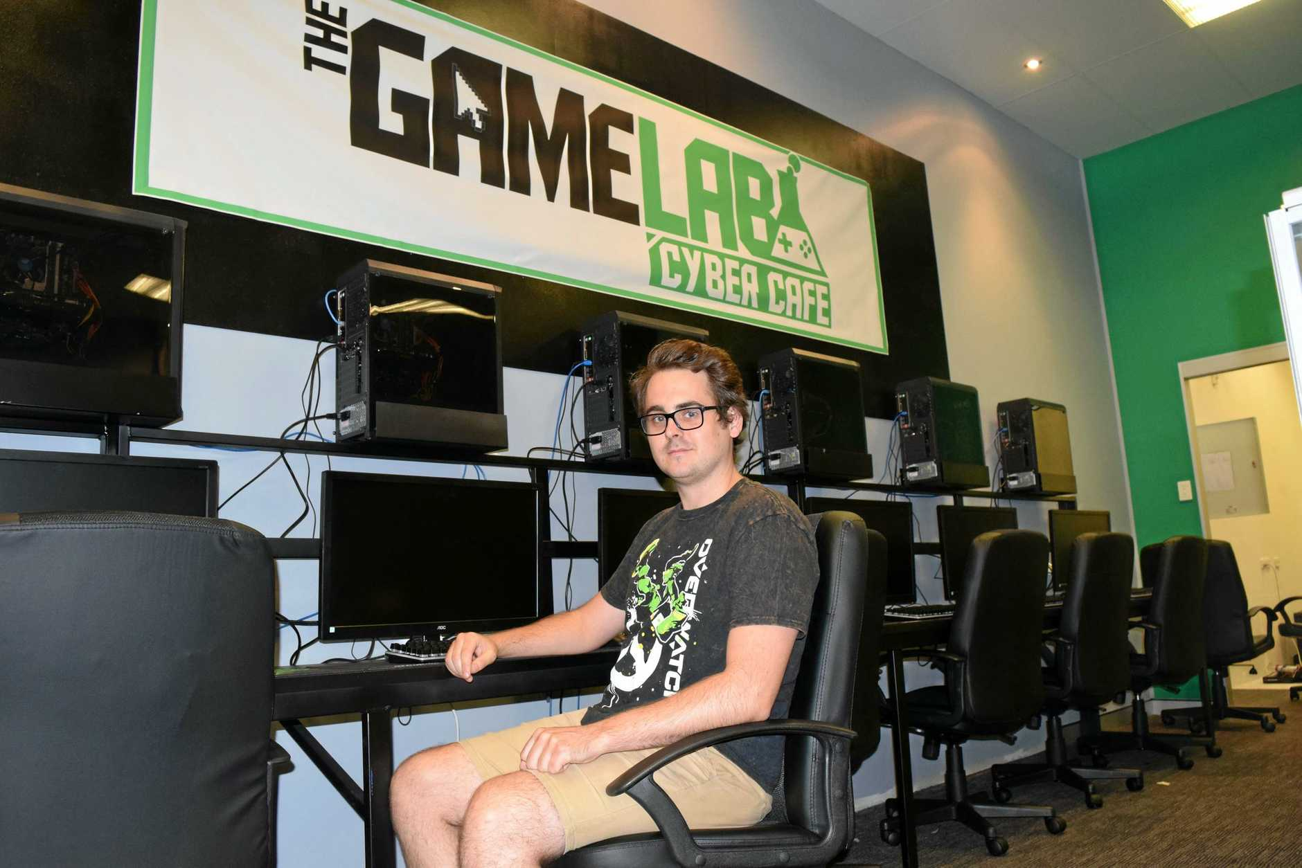 GOING CYBER: Chris Shanahan puts some of the final touches on the Game Lab Cyber Cafe ahead of its opening on Friday. The store will feature about 18 computers and four consoles for game enthusiasts to play on.