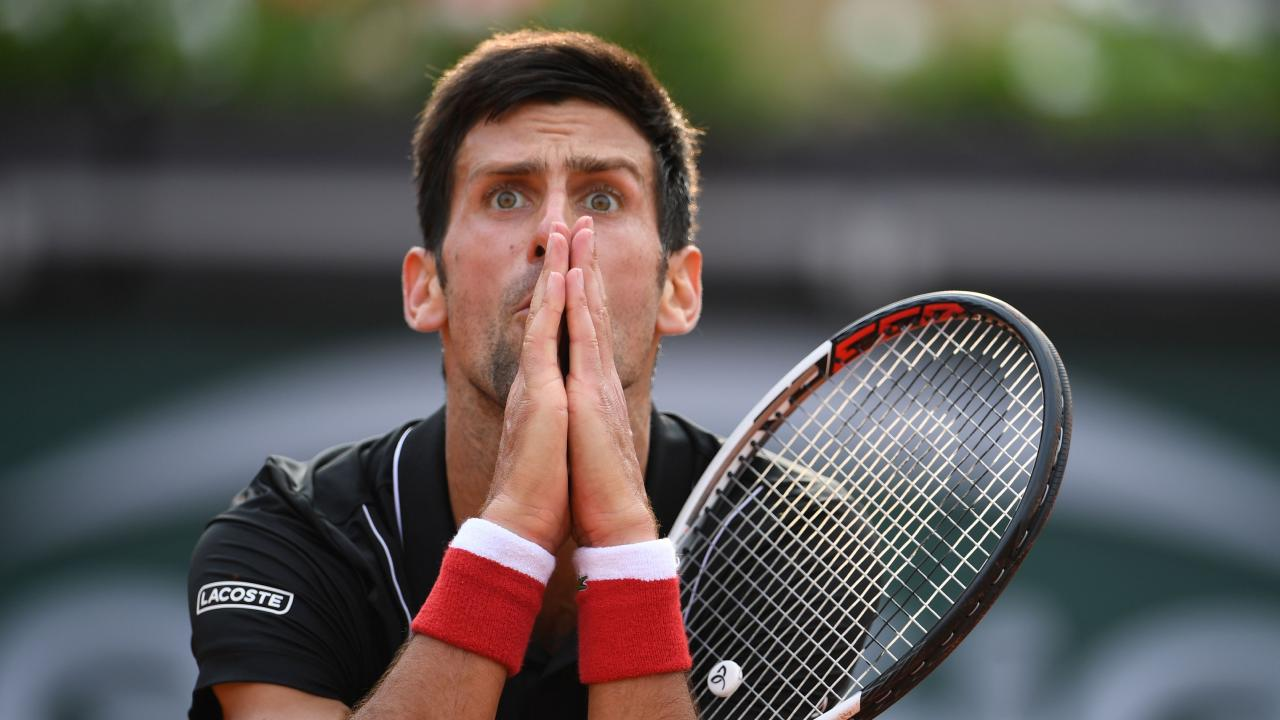 Novak Djokovic reacts after a point in the fourth set against Italy's Marco Cecchinato. Photo: Eric Feferberg
