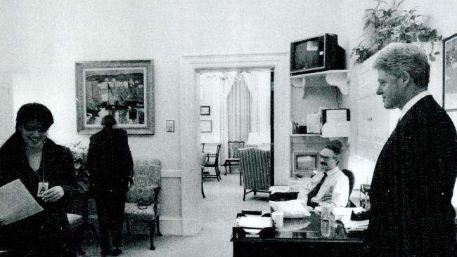 A photograph showing former White House intern Monica Lewinsky (L) working in a White House office as President Bill Clinton looks on. Picture: Supplied