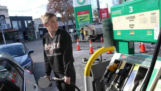 Gemma Sutherland fills up at BP on Swan Street, Richmond. Picture: David Crosling