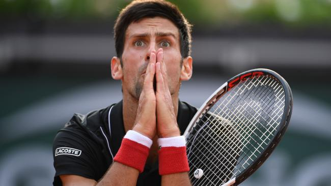 Serbia's Novak Djokovic reacts after a point in the fourth set against Italy's Marco Cecchinato.