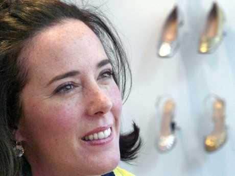 Designer Kate Spade poses with shoes from her collection in New York. Picture: AP
